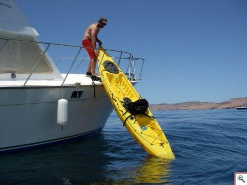 Allen hoisting a kayak onto the mothership